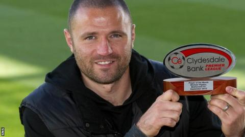 Motherwell striker Michael Higdon with his Clydesdale Bank award