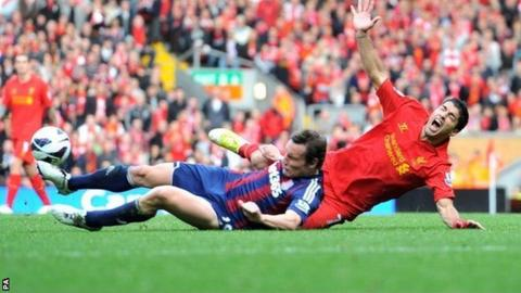 Luis Suarez is challenged by Stoke's Dean Whitehead
