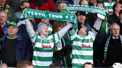 Fans cheer on Yeovil Town during their FA Cup match with Liverpool in 2004