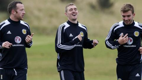 Scotland captain Darren Fletcher (centre) shares a joke with Charlie Adam and James Morrison