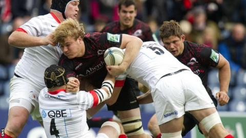 David Denton (centre) is closed down by Saracens' Matt Stevens, Steve Borthwick (4) and Mouritz Botha