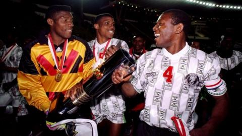 Peter Rufai (left) celebrates with the Nations Cup trophy in 1996