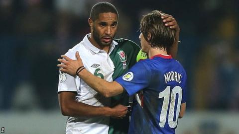 Wales captain Ashley Williams (left) is consoled by Croatia's Luka Modric