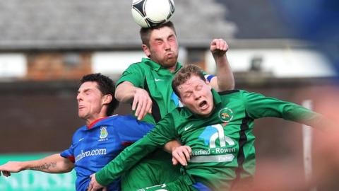 Mark Stafford (centre) and Mark McConkey in aerial action against Linfield's Daryl Fordyce