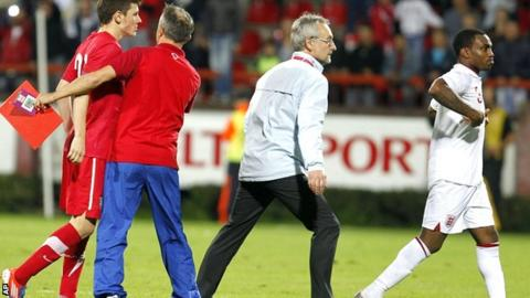 Danny Rose (right) leaves the field after being sent-off against Serbia U-21
