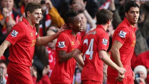 Raheem Sterling (second left) celebrates his goal for Liverpool