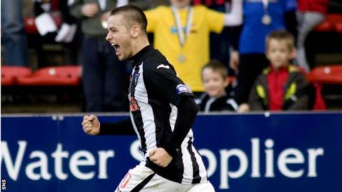 Wallace celebrates his equaliser for Dunfermline