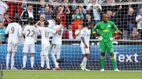 Michu celebrates his goal