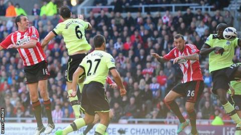 John O'Shea (left) header comes off Demba Ba (right) before going into the Newcastle net