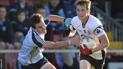 Mayobridge player Kevin McClorey in action against Kilcoo opponent Paul Devlin at Pairc Esler