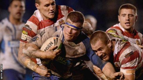 Stuart Dickens (centre) playing against Wigan