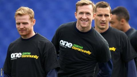 Players from Championship side Birmingham wear Kick It Out T-shirts