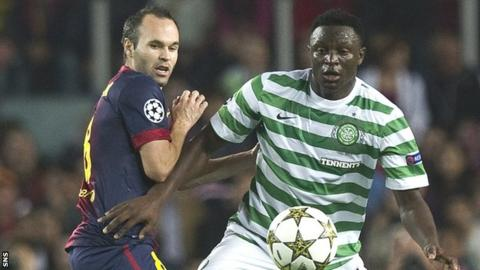 Andres Iniesta of Barcelona is challenged by Wanyama in Spain