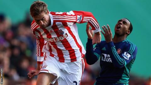 Stoke's Pete Crouch (l) tangles with Danny Rose