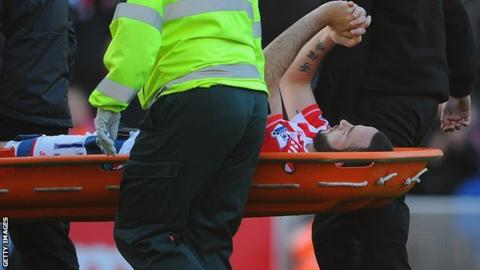 Marc Wilson is stretchered off