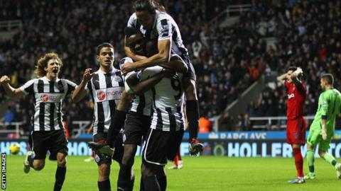 Newcastle celebrate Papiss Cisse's winner
