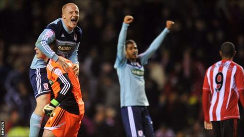 Middlesbrough players celebrate on the final whistle