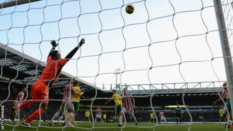 Stoke goalkeeper Asmir Begovic cannot keep out Bradley Johnson's first-half header