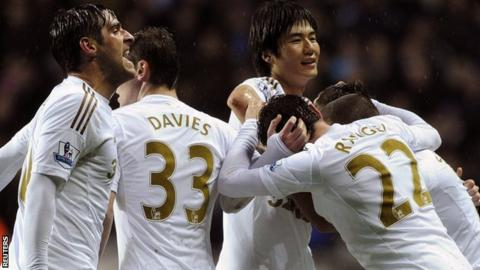 Swansea celebrate their late equaliser against Chelsea