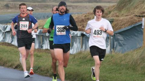Elliott Dorey leads the race