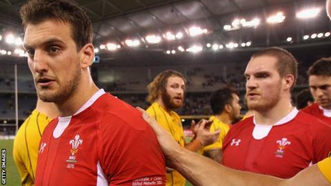 Wales captain Sam Warburton (left) leaves the field after an agonising 20-19 loss to Australia in June