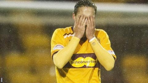 Motherwell's Tom Hateley hangs his head after losing out to Dundee Utd by a single goal
