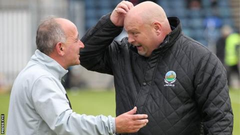 Cliftonville manager Tommy Breslin and David Jeffrey of Linfield