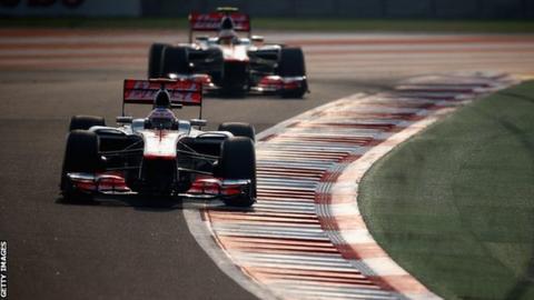Jenson Button (front) and Lewis Hamilton