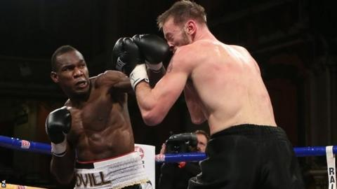 Ovill McKenzie lands a solid left on Enzo Maccarinelli