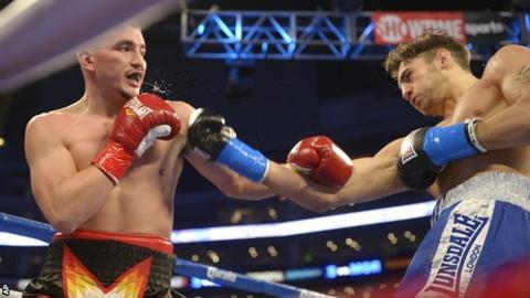 Nathan Cleverly (right) lands another blow against Shawn Hawk