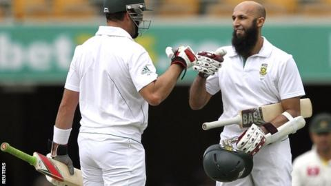 Jacques Kallis (left) and Hashim Amla celebrate their partnership at the Gabba