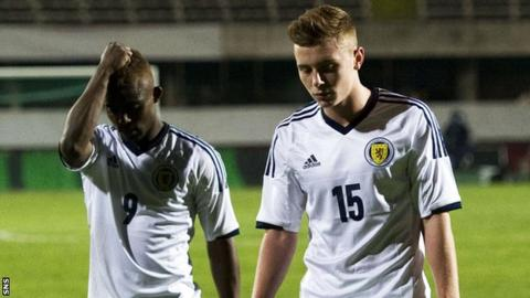 Islam Feruz and Lewis MacLeod look dejected