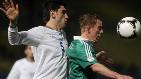 Azerbaijan defender Rasim Ramaldanov challenges Dean Shiels