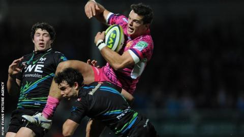 Osprey Tom Habberfield tackles Exeter's Mark Foster