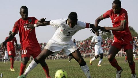 Malawi players in action with Ghana