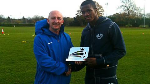 Ian Holloway (left) gives Wilfried Zaha his award