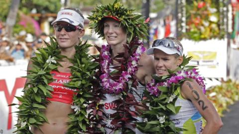 Leanda Cave, covered in traditional Hawaiian garlands, tops off a fine 2012 by adding the Ironman World Championship title to the Half-Ironman World Championship victory she claimed earlier in the year