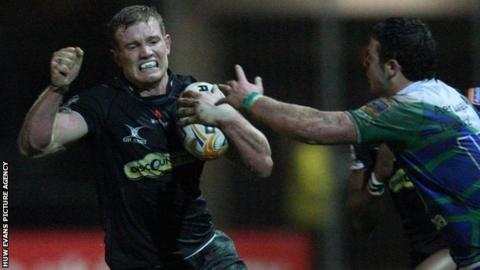 Pat Leach is about to be halted, but he goes on to score the game's opening try for the Dragons