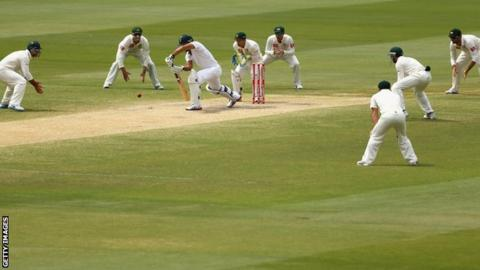 Faf du Plessis is surrounded by fielders