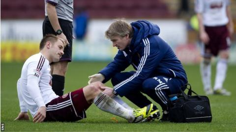 The Hearts physio tends to Danny Grainger