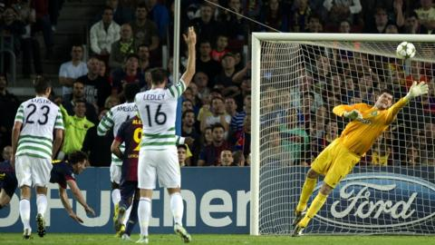 Celtic keeper Fraser Forster (right) makes a great save