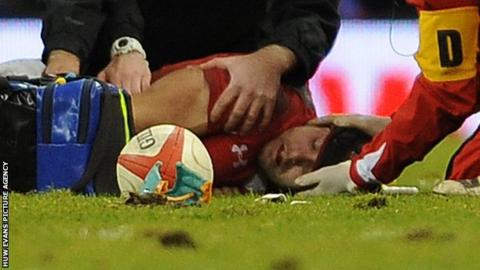 Leigh Halfpenny receives treatment on the field