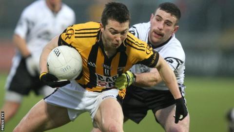 Crossmaglen's Stephen Kernan is challenged by Donal Kane