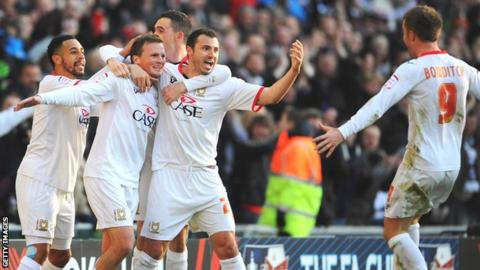 MK Dons players celebrate