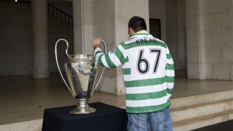 A Celtic fan with the European Cup won by the club in 1967
