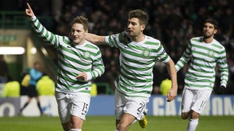 Kris Commons (left) celebrates his winning penalty against Spartak Moscow