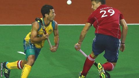 Australia's Jamie Dwyer gets to the ball ahead of England's Richard Smith