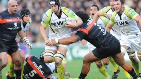 Ryan Jones runs into strong Toulouse defence as the Ospreys are beaten 30-14 in Pool 2 of the Heineken Cup