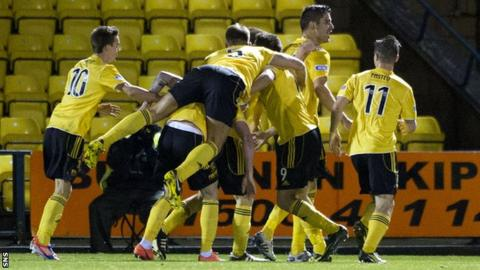Jesus Garcia Tena (2nd from right) is congratulated by his team mates after scoring to give Livingston the lead