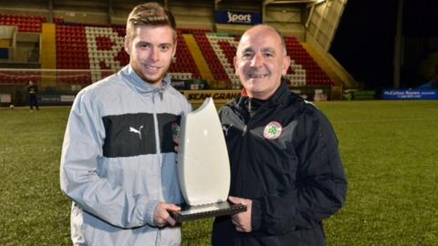 James Knowles receives his award from his manager Tommy Breslin